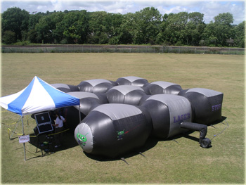 Laser tag guns for hire as part of an inflatable laser tag arena such as laser quest or quasar shooting game